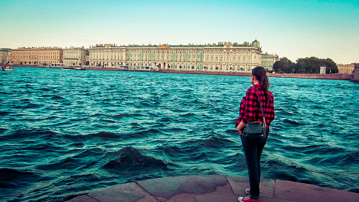 Woman overlooking the Hermitage museum and lake in St Petersburg, Russia