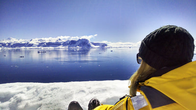 Woman looks out over Antarctica's landscape