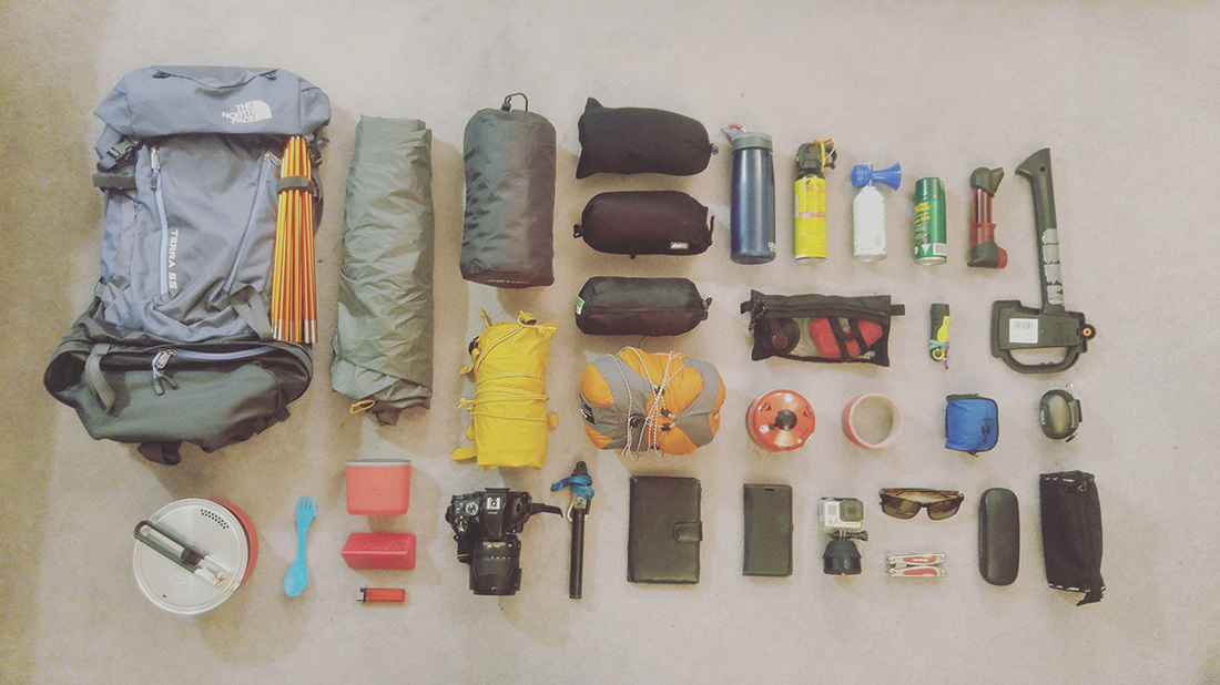 A woman's hiking backpack and contents