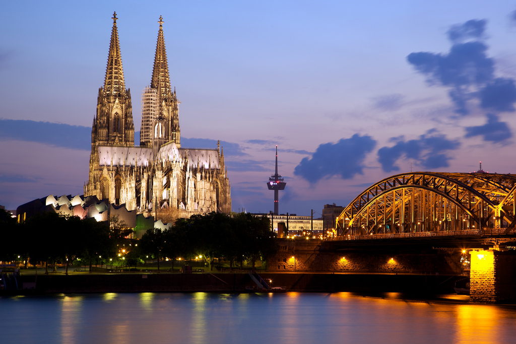 The Cologne Cathedral and bridge at night