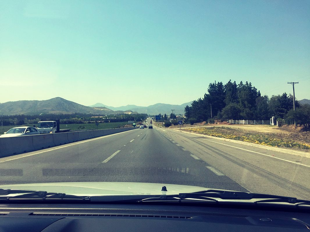View of Chilean highway looking out from inside a vehicle