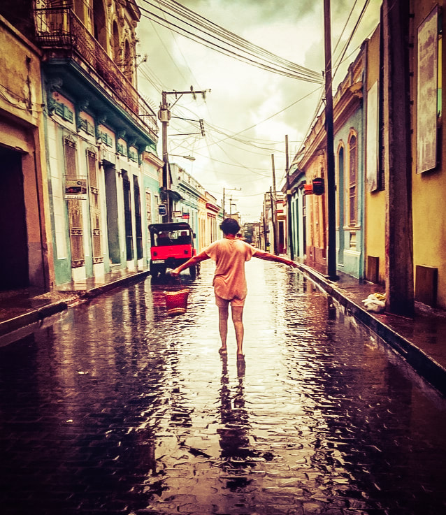 Standing on the street in the rain in Cuba
