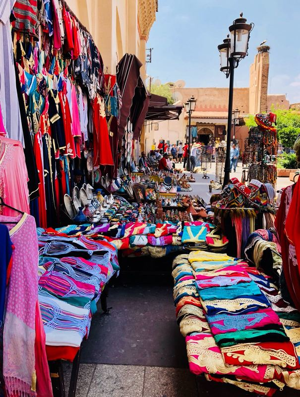 A typical market stall at one of Marrakesh's traditional souks in Morocco selling beautiful scarves, clothing and shoes