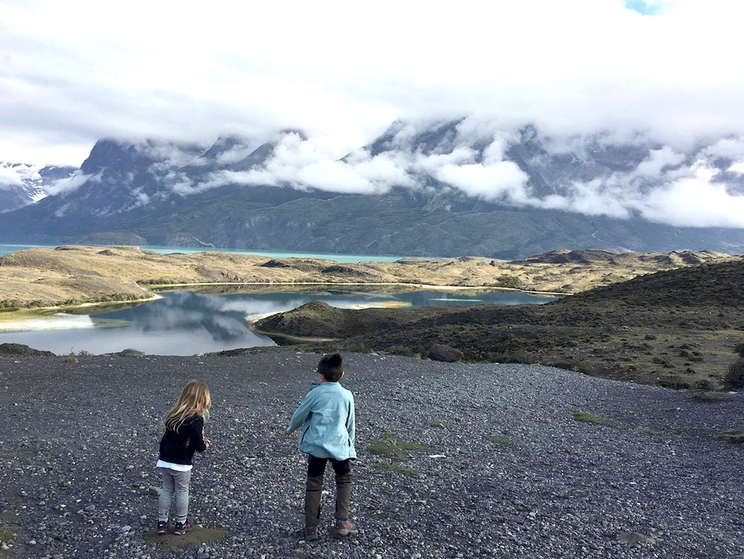 Picture of a boy and girl playing in the sand on a lake - Torres del Paine, Patagonia