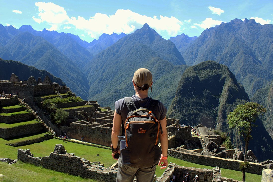 Hiking woman overlooks Machu Picchu