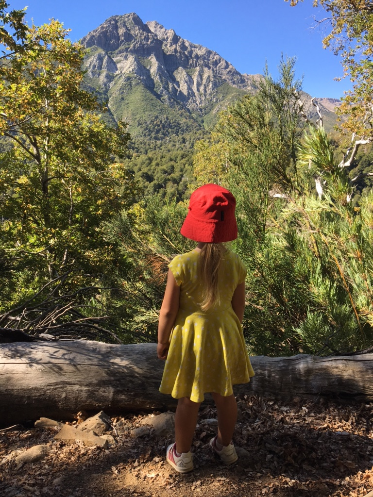 Little girl overlooks Chilean mountains on a sunny day