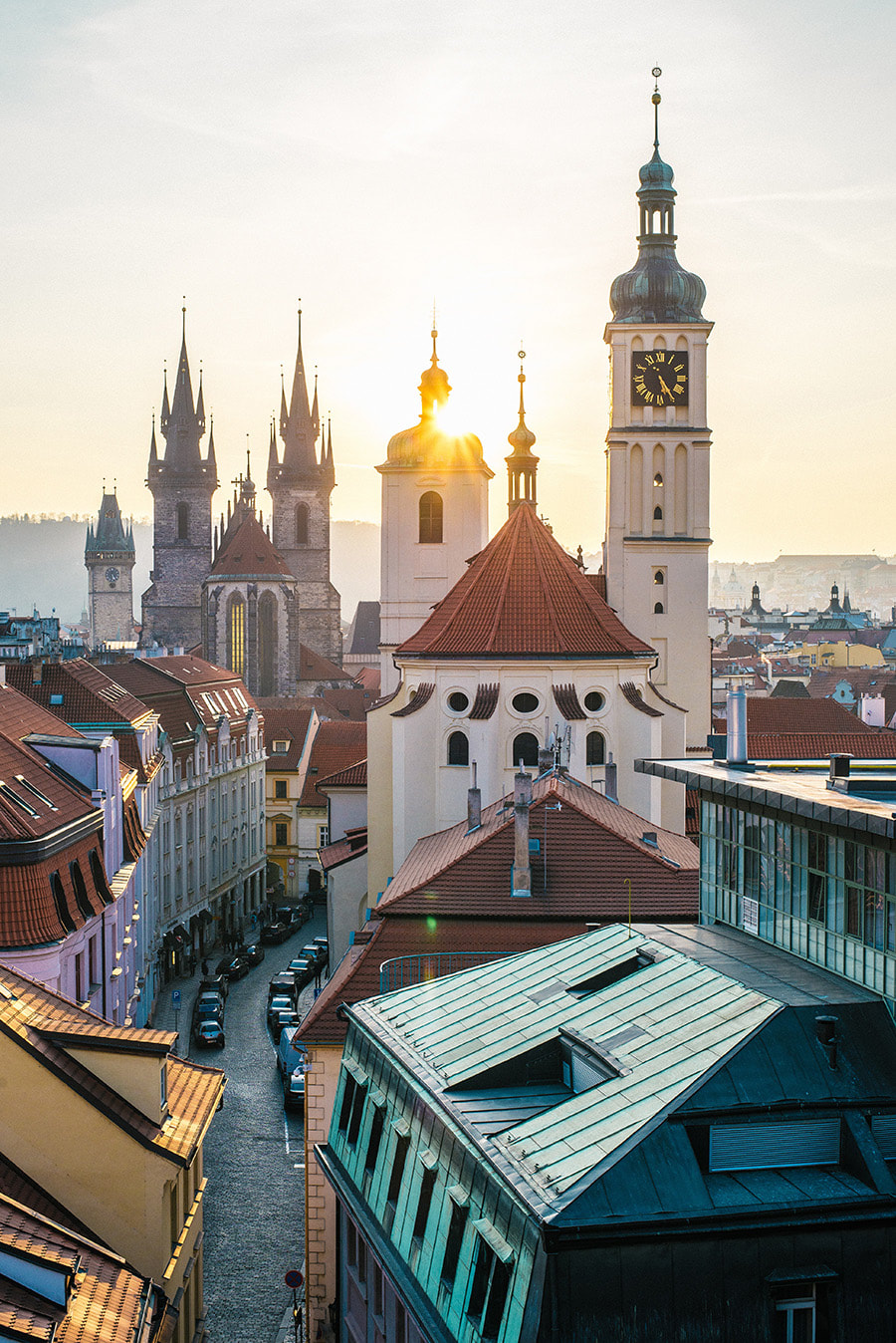 The sun peeks through the stunning architecture of Prague, Czech Republic