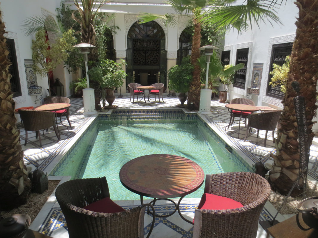 Courtyard with pool in a traditional Moroccan Riad in Marrakesh