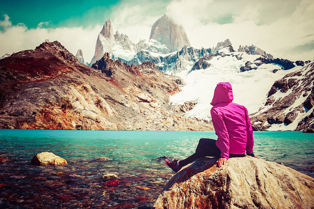 Woman overlooking a lake on the Torres del Paine trek in Patagonia South America