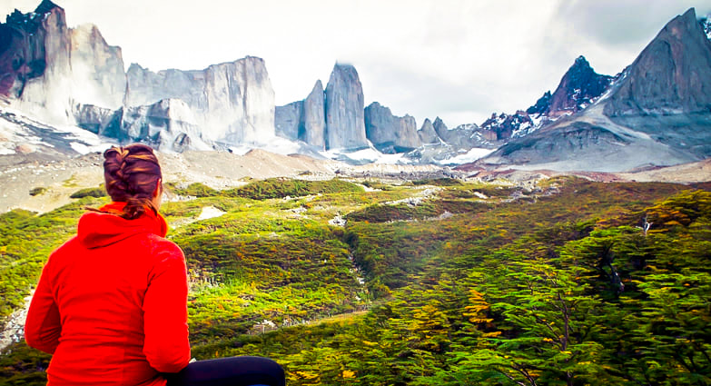 Woman overlooking mountains in Patagonia, South America