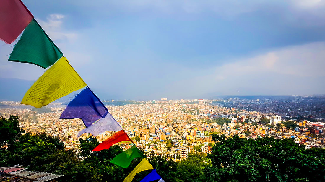 View over the city of Kathmandu in Nepal on a sunny day with clear blue skies in the background